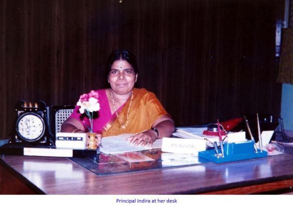 indira at her desk-captioned