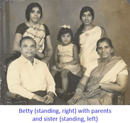 Betty with her sister and parents-captioned