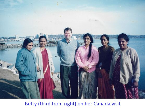 Betty with Poly staff and Canadian in Canada-captioned